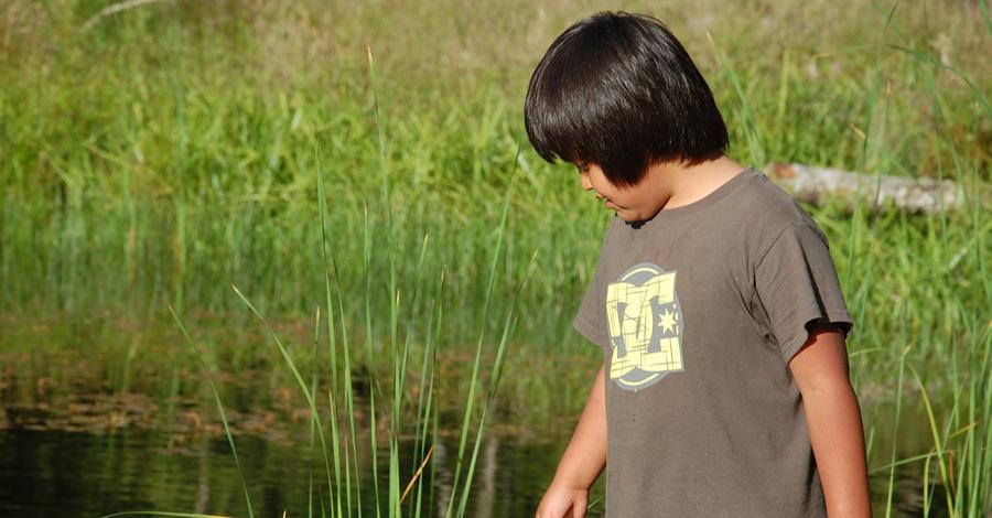 child at wetland