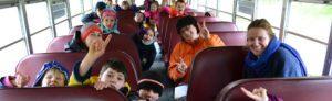 happy kids on school bus